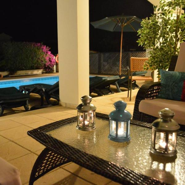 villa corallia evenings by the pool
