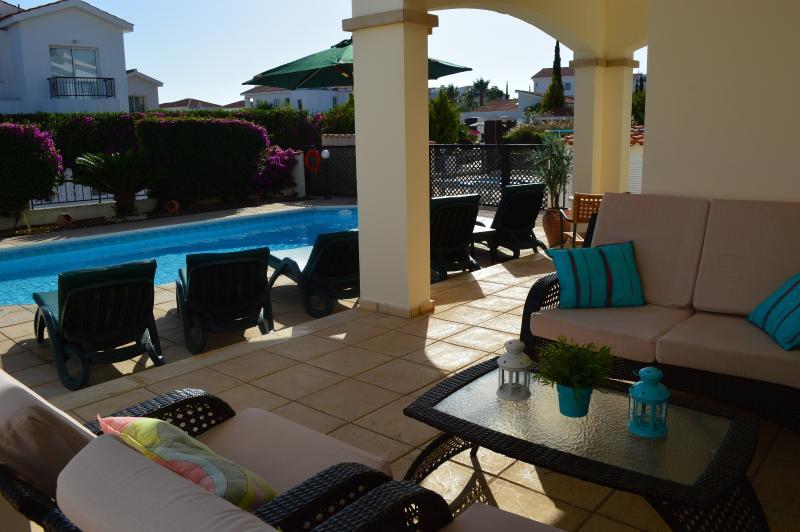 villa corallia poolside area